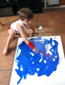 Raffi is beginning his 3 year old painting.