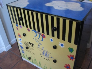 Maggie and Raffi's dresser for art storage.