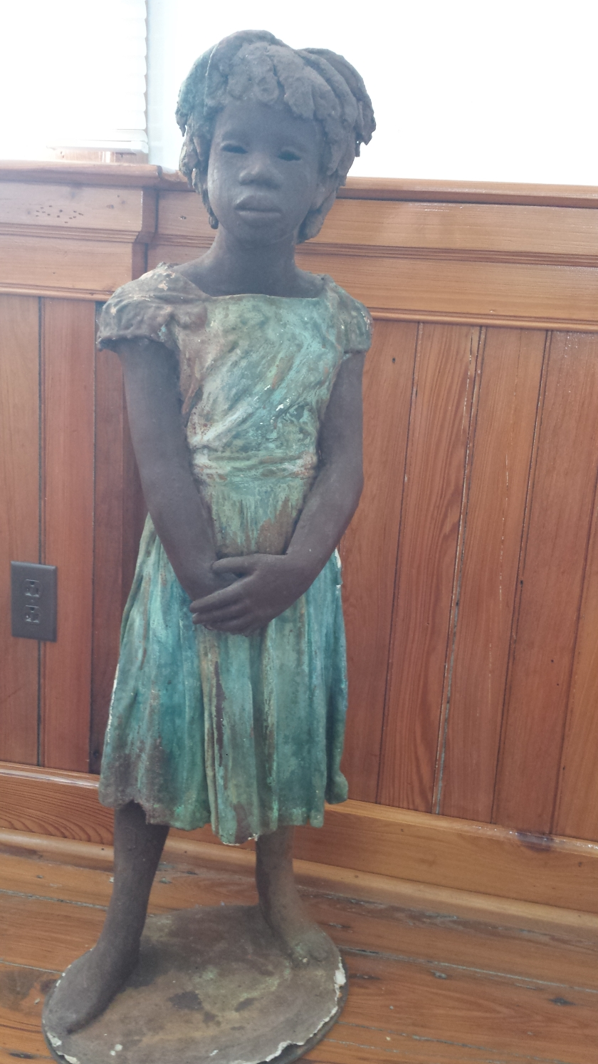 One of many statues of the different children enslaved on Whitney Plantation